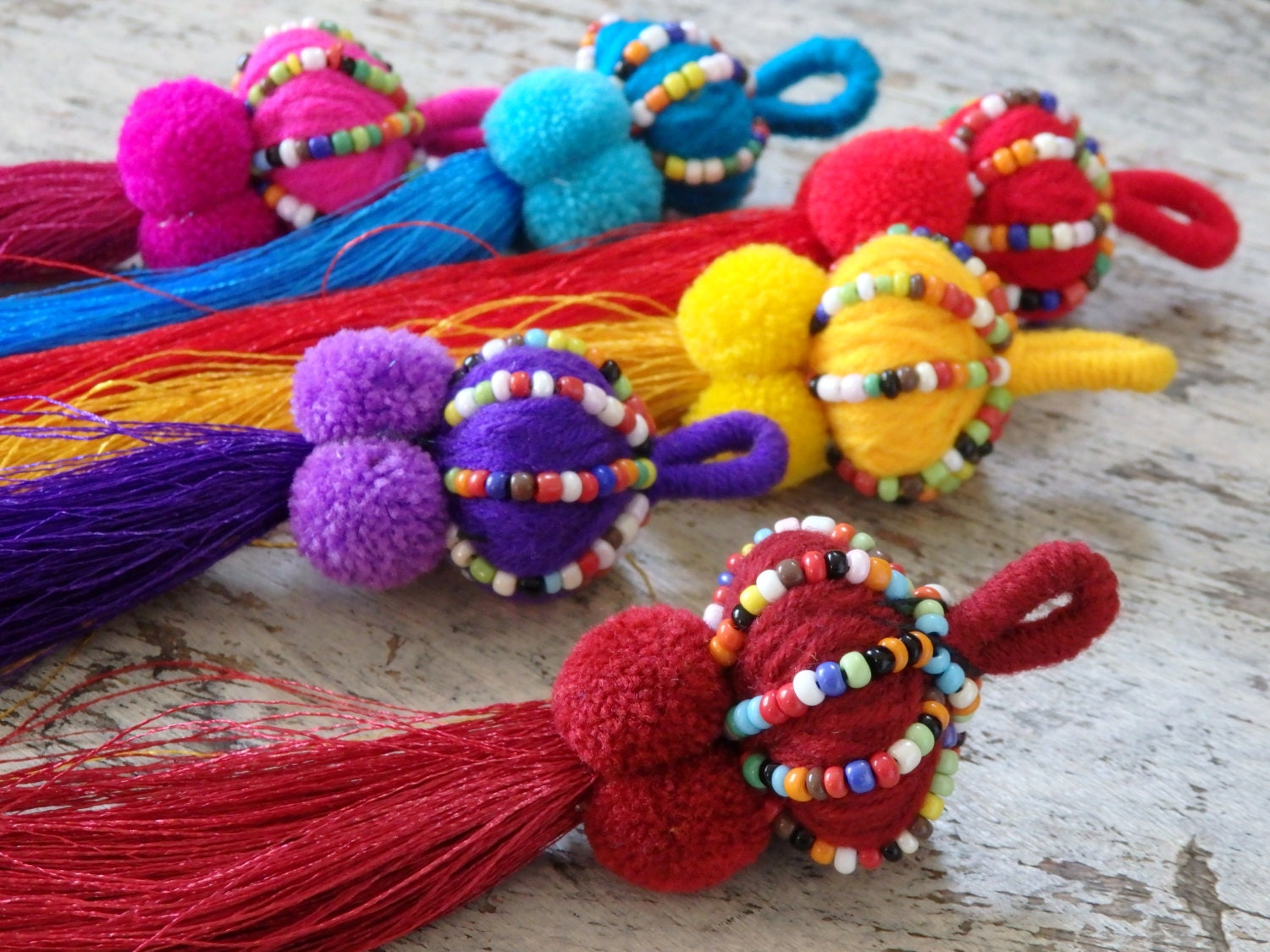 thai beaded tassel one large tassel with pompoms by