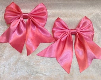 pair of large pink hair bows with tails anime bows