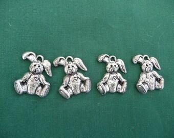 Set of four pewter mini bunny jewelry pieces