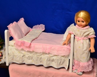 Pretty in pink American Girl style bed and bedding with matching nightgown and slippers