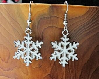 SALE Winter White snowflake Earrings.    Holiday earrings.  Christmas.    Surgical steel Earwires.  Enameled metal alloy  Snowflakes
