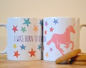 I was born to be a Unicorn. Pink Unicorn and Colourful stars on this mug.By Bethany Moore