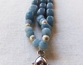 Three strand blue cabachon bracelet with chain dropped earrings.