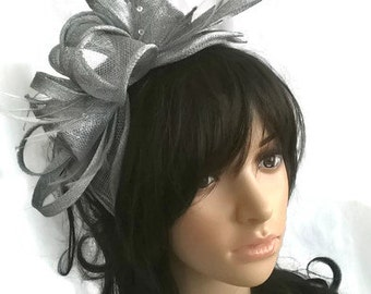 Silver Feather Fascinator..stunning  rosette fascinator on a headband