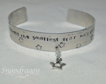 Stamped aluminium cuff, ''Even in the darkness the smallest star will shine''