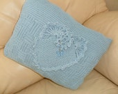 Hand Knitted cushion.  Blue with heart design. Pad included.