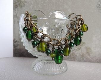 Green glass beaded charm bracelet
