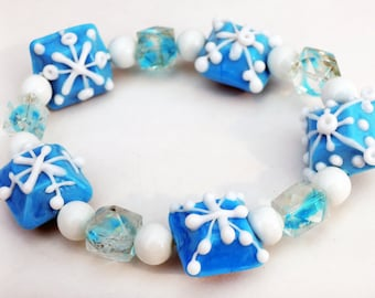 Baby Blue and White Snowflake Beaded Elastic Bracelet Handmade by Lindsey - Lampwork Beads - Snowflake Beads - Winter Jewelry