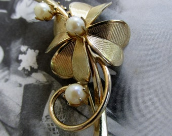 Gold Tone Vintage Brooch of an Etched Flower with Three Pearls