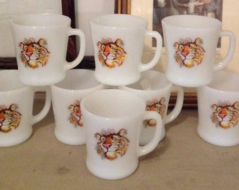 Set of 8 vintage Fire King Tony the Tiger mugs