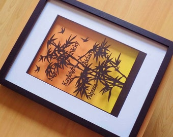 A different kind of family tree! Bamboo tree family tree papercut in a shadow box frame