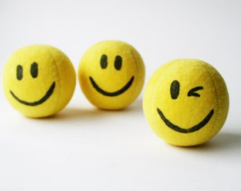 Set of 3 handmade, 2.5inch juggling balls with packaging and instructions in yellow and red smiley face