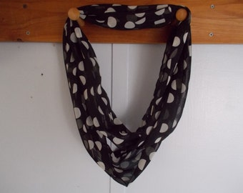 "Infinity Scarf. Black with white polka dots.  Approx 5"" x 72"".  Great light weight scarf to add color  to your outfit."