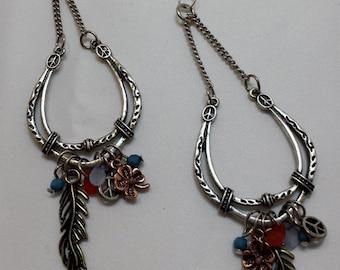 Horseshoe silver dangle earrings.