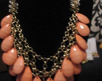 Peach bobble tear drop bobble necklace in gold tone