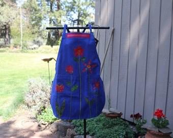 Garden apron in cobalt denim with flowers