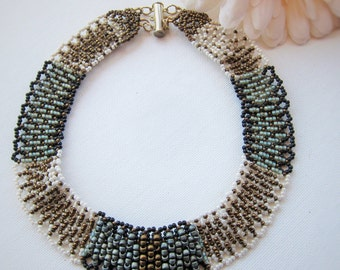 Colorful Beaded Netted Collar Necklace In Blue, Black, And Bronze