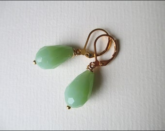 brazen earrings with faceted green  glass beads