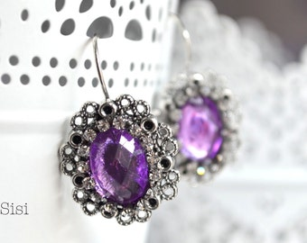 Silvered ears purple cabochon