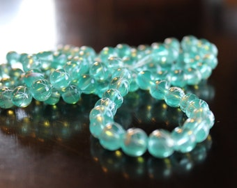 100 approx. 8 mm drawbench transparent glass beads, sea glass green, with spray painted white lines, hole 1.3-1.6 mm