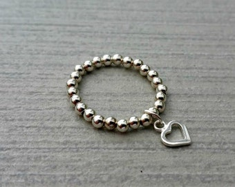 Sterling silver beaded stretch charm ring