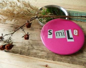 "Smile.  Pocket mirror, 59mm, Ø 2.25 inch, diameter 2.25"", 2 1/4"