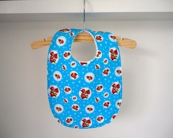 Bib with romantic floral print