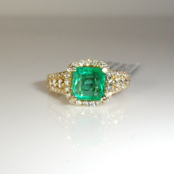 1 61 carat zambian emerald with halo ring by