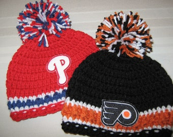 Crochet Beanie Baby Hat (Philadelphia Flyers) Embroidered Logo - Black, Orange and White with embroidered Flyers logo and large pom pom