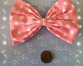 Large light pink and white pola dot hair bow