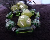 Goblin RPG polyhedral dice set with green jewlery and mesh bag D&D Pathfinder