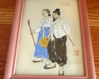 Asian couple sketch in black pen and ink, and appears to be hand colored.