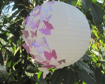 Indoor outdoor paper lantern partially accented with 2 color paper butterflies for weddings, parties