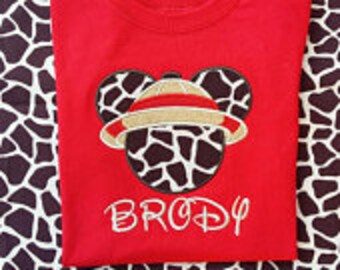 Mickey Mouse safari Giraffe print head with tan safari hat with red trim on a red T-shirt. Inspired by Disney's Animal Kingdom.