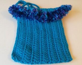 Bright blue purse with fun fur ruffled trim