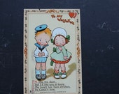 Antique Raphael Tuck & Sons Valentine Embossed Postcard 1910s Innocence Abroad