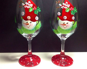 Snowmen; who doesn't love them. LIVE is the word on this wine glass, these adorable snowmen have such personality.  Set of 2.