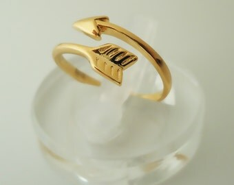 64.    Gold Plated, Arrow ring, adjustable ring