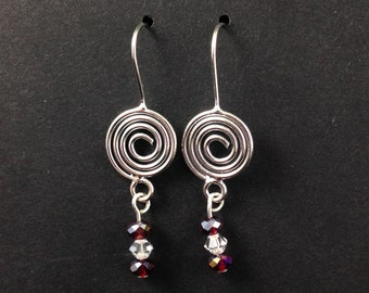 Silver swirl and red crystal earrings