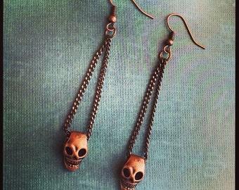 earrings with skulls