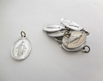 Ten identical French religious medals, Aluminum charms, 1940. Jewelry supplies. French Vintage