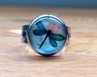 Round dragonfly cabochon ring.
