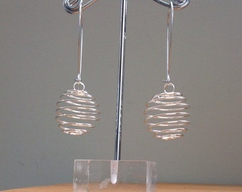 Empty silver spiral cage earrings
