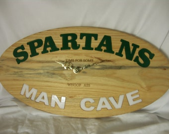 Spartans man cave sign. Also a wall clock. Made in Michigan.