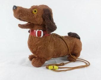 Vintage battery powered toy dog dauchound. Super cute!!!