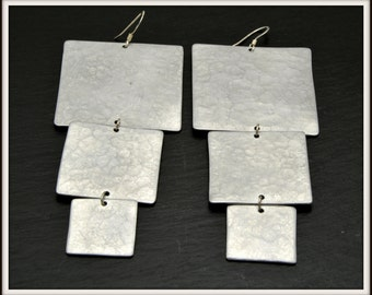 Pending aluminum earrings