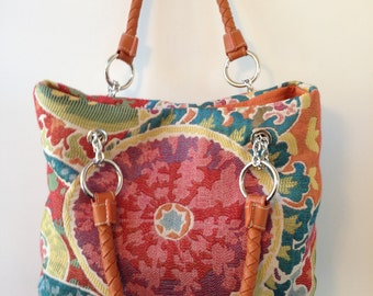 Think happy thoughts with this colorful handbag
