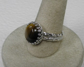 This ring is a tigereye size 9.