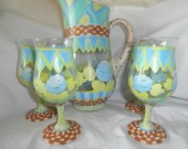 Spring  sangria pitcher and 4 goblet set. Blue/teal roses, stripes,checks,swirls. Gold,teal,blue,green,brown and tan. Hand painted ,,