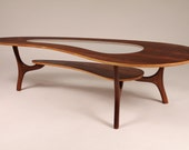 1960 WALNUT COFFEE TABLE (veneer) kidney shaped with center glass top ( fully  restored )